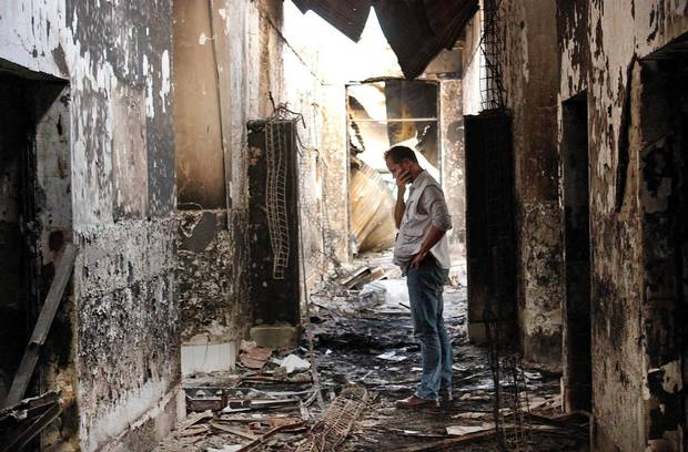 A MSF employee walks inside the charred remains of the organization's hospital after it was hit by a U.S. airstrike in Kunduz, Afghanistan in October, 2015.