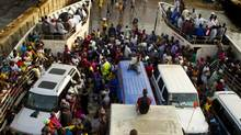 Hundreds, if not thousands, of people crowd onto the morning ferry to make their way from the Lungi area south across the Sierra Leone River to Freetown in this April 17, 2012, file photo. (Peter Power/The Globe and Mail)