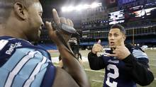 Toronto Argonauts Walter Spencer interviews his teammate Chad Owens (2) during a practice ahead of the 100th Grey Cup in Toronto, November 24, 2012. (MATHIEU BELANGER/REUTERS)