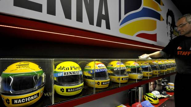 Helmets that belonged to late Brazilian driver Ayrton Senna on display at the the Imola track, Italy. (Marco Vasini/AP)