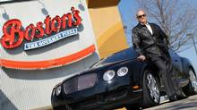 Jim Treliving, owner of the Boston's Pizza chain, photographed with his Bentley in front of one of his restaurants in Irving, Texas, March 3, 2010. (Courtney Perry For The Globe and Mail)