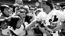 Montreal Expos catcher Gary Carter is mobbed by admiring fans in this 1983 photo (Bernard Brault/THE CANADIAN PRESS)