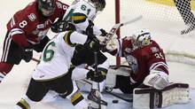 Guelph Storm goalie Justin Nichols and Robby Fabbri try to cover the puck as London Knights Ryan Rupert and Matt Rupert try to score during first-period action at the Memorial Cup in London, Ont., on Wednesday, May 21, 2014. (Dave Chidley/THE CANADIAN PRESS)