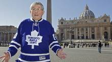 Archbishop of Toronto Thomas Collins wears a Toronto Maple Leafs jersey as he walks in St. Peter's Square in the Vatican, Thursday, Feb.16, 2012. Collins, 65, is about to become the 16th Canadian to be elevated to the position of cardinal, an elite group of advisers handpicked by the Pope. (THE CANADIAN PRESS)