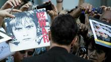 U2 frontman Bono greets fans as he arrived for a screening of the new documentary From the Sky Down at the Toronto International Film Festival on Thursday night. (Nathan Denette/The Canadian Press)