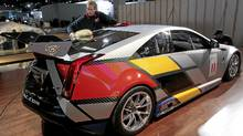 Michael Price cleans a Cadillac CTS-V coupe race car before its debut for press days at the North American International Auto show in Detroit, Michigan January 8, 2011. (Rebecca Cook/Reuters/Rebecca Cook/Reuters)