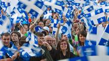 A crowd waves Quebec flags during the St. Jean Baptiste celebrations on the Plains of Abraham on June 23, 2009. (Francis Vachon/Francis Vachon for The Globe and Mail)