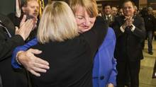 Newfoundland and Labrador Premier Kathy Dunderdale hugs cabinet minister Susan Sullivan after announceing her resignation in St. John's on Jan. 22, 2014. (GREG LOCKE/REUTERS)