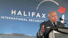 Canadian Lt.-Gen. Charles Bouchard, who commanded the recent NATO military mission in Libya, gestures while speaking to the media on Saturday, November 19, 2011 at the Halifax International Security Forum taking place in Halifax, Nova Scotia. (Mike Dembeck/THE CANADIAN PRESS)