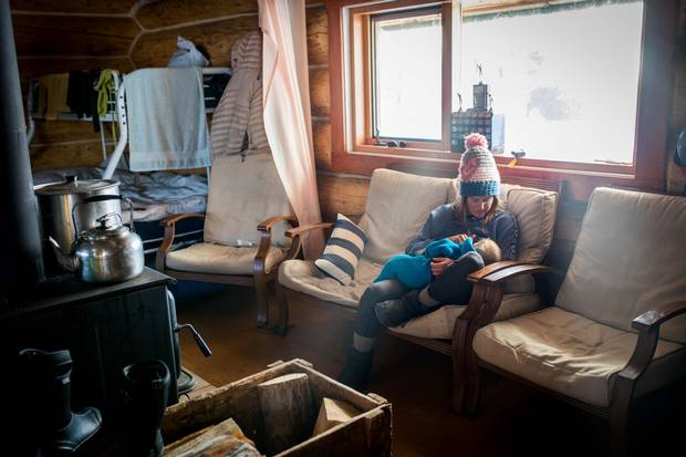 Tessa Treadway breastfeeds her son Raffi at Tweedsmuir Ski Club's backcountry cabin.