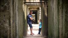 The writer, Graeme McRanor, and his son on the road in Angkor Wat. (Suzy Patrick)