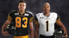 Hamilton Tiger-Cats Andy Fantuz and Henry Burris model the team's new jerseys. (ticats.ca)