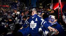 Fans celebrate as the Toronto Maple Leafs score against the Boston Bruins. (Michelle Siu for The Globe and Mail)