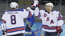 USA forward Phil Kessel, right, celebrates his second goal with teammate Joe Pavelski during the 2014 Winter Olympics men's hockey game against Slovenia at Shayba Arena Sunday, Feb. 16, 2014, in Sochi, Russia. (Matt Slocum/AP)