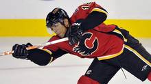 Calgary Flames captain Jarome Iginla takes a shot that scored a goal during the third period of their NHL pre-season hockey game against the Vancouver Canucks in Calgary, September 21, 2010. (TODD KOROL)