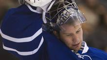 Toronto Maple Leafs goalie James Reimer looks down after allowing two goals early in first period NHL hockey action against the Washington Capitals during in Toronto on Saturday, Feb. 25, 2012. THE CANADIAN PRESS/Nathan Denette (Nathan Denette/CP)