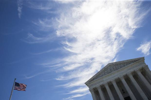 A flag flies outside the U.S. Supreme Court building in Washington, D.C.