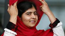 Malala Yousafzai, the Pakistani girl who was shot in the head by the the Taliban for advocating girls' education, reacts after speaking at the opening of Birmingham Library in central England September 3, 2013. (DARREN STAPLES/REUTERS)