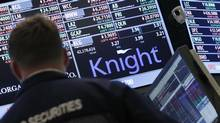 Knight Capital Group Inc., one of the largest U.S. market makers, said it is 'actively pursuing its strategic and financing alternatives,' raising the possibility Knight could be sold or even face bankruptcy. (BRENDAN McDERMID/REUTERS)