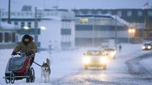 The twilight of the midday sun lights the way down the main street in Inuvik. (JONATHAN HAYWARD/The Canadian Press)