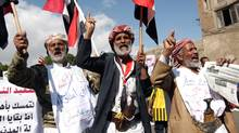 Yemeni protesters shout slogans during an anti-regime demonstration in Sanaa on November 27, 2011 as President Ali Abdullah Saleh returned to Yemen from Riyadh, where he signed a deal to step down under which a new presidential poll is take place in February, state news agency Saba reported. (MOHAMMED HUWAIS/AFP/Getty Images/MOHAMMED HUWAIS/AFP/Getty Images)