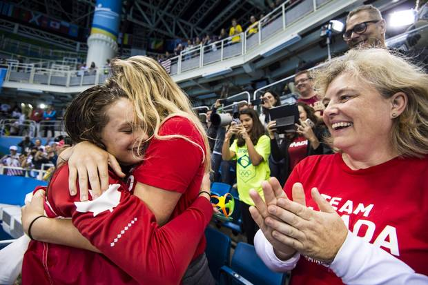 Penny Oleksiak with family members after she won gold in the women's 100-metre freestyle final at the Olympic Aquatics Stadium during the Rio 2016 Olympics on August 11, 2016.