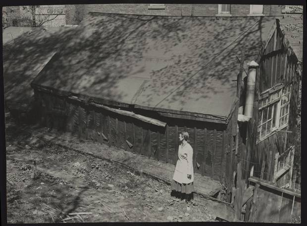 MAY 2, 1957 -- TOM THOMSON'S SHACK -- Sculptor Frances Gage standing outside Tom Thomson's shack in Toronto in May, 1952. Gage had been using it as a studio.