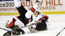 Ottawa Senators forward Milan Michalek, left, collides with teammate Erik Karlsson during the second period of an NHL hockey game in Buffalo, N.Y., Tuesday. (David Duprey/Associated Press)
