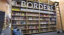 A woman reads in a Borders book store on Tuesday, May 22, 2007 in New York. Borders Group Inc. is expected to release quarterly earnings on Tuesday, May 29, 2007. (AP Photo/Mark Lennihan)