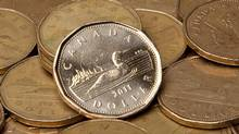 Canadian dollars (loonies) are pictured. (JONATHAN HAYWARD/THE CANADIAN PRESS)