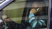 A driver talks on his cell phone while driving in downtown Ottawa, Ont., Wednesday September 30, 2009. Steps must be taken to dissuade drivers from illegally using cellphones while behind the wheel to prevent the risk of injury to other motorists or pedestrians, says an editorial by two Canadian doctors. (Sean Kilpatrick/THE CANADIAN PRESS)