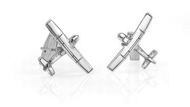 These sterling-silver cufflinks ($198) will remind him that even when he's stuck in the most boring work meeting, adventure is just around the corner. Buy online at studio1098customjewellery.com.
