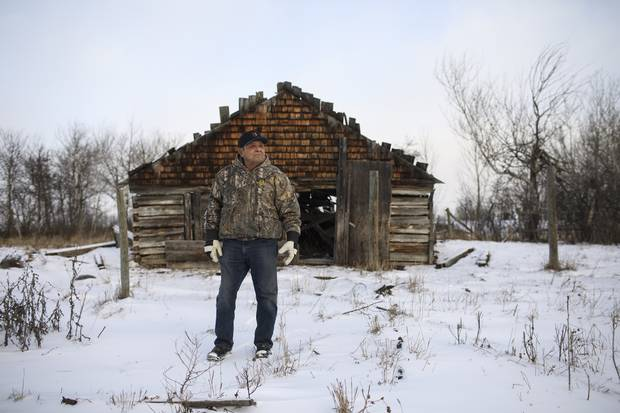 Fred Sasakamoose stands in front of the house where he was born at the Ahtahkakoop Cree Nation in Saskatchewan. He was the first aboriginal person to play in the NHL.