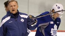 Toronto Maple Leafs head coach Ron Wilson keeps an eye on the team's practice Friday, March 2, 2012 in Brossard, Que. THE CANADIAN PRESS/Ryan Remiorz (Ryan Remiorz/CP)