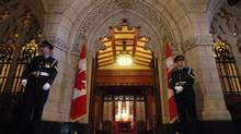 Senate security waits for the start of Question Period outside the Senate chamber June 04, 2013 on Parliament Hill in Ottawa. (Dave Chan For The Globe and Mail)