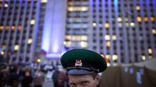 A man wearing a Soviet military hat poses for a picture outside a regional government building in Donetsk, in eastern Ukraine April 21, 2014. (MARKO DJURICA/REUTERS)