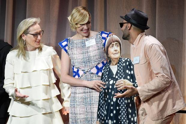 Meryl Streep, Greta Gerwig and JR, holding a cardboard cutout of collaborator Agnes Varda, attend the Academy Awards nominee luncheon on Feb. 5, 2018.