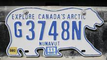 Nunavut's licence plate design was the same as that of the Northwest Territories from 1999 until this past July. The shape of the plate is now the traditional rectangle, although it still features a polar bear on it. (CHRIS WATTIE/REUTERS)