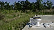 A toilet is seen where a house stood before Hurricane Katrina struck. (CARLOS BARRIA/Reuters)
