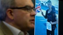 A photo of missing British tourist Tom Billings, 22, is displayed as his father Martin Billings speaks to the media during a news conference at Vancouver Police headquarters on Dec. 9, 2013. (Darryl Dyck for The Globe and Mail)
