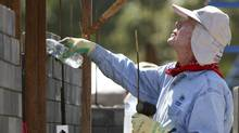 "Former U.S. President Jimmy Carter takes part in building efforts during the ""Jimmy & Rosalynn Carter Work Project 2009"", as part of the Habitat for Humanity program, in Chiang Mai province, north of Bangkok, November 16, 2009. (STRINGER/REUTERS)"