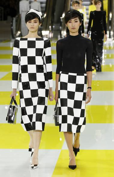 BLACK AND WHITE ALL OVER: Get ready to go graphic. No matter which way it played out – harlequin diamonds (at Balmain), power flowers (at Prada and Viktor & Rolf), abstracted patterns (at Chloe and Marc Jacobs), checkerboards (at Louis Vuitton) or contoured shapes (at Elie Saab, Valentino and Calvin Klein) – the classic pairing ruled the runways. Why? Because designers clearly want to flush out last year's explosion of eccentric prints. Even when black and white got a boost from added colour – see Mary Katrantzou, Roberto Cavalli, Roksanda Ilincic, Peter Pilotto and Karl Lagerfeld at Fendi – the impact was undeniable. Consider this fashion's take on high definition. – A.V. (Benoit Tessier/Reuters)