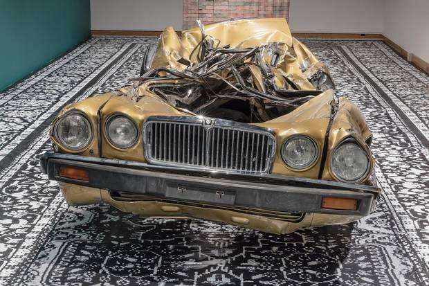 Divya Mehra's gold-painted 1987 Jaguar Vanden Plas represents the damaged American Dream.