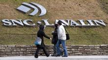 Pedestrians walk past the SNC-Lavalin office in Montreal in this file photo. (Ryan Remiorz/The Canadian Press)