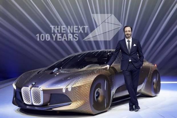 Karim Habib, BMW's head of design, stands next to the Vision Next 100.