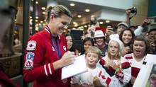 Team Canada soccer captain and Olympic bronze medalist, Christine Sinclair, signs autographs for fans after arriving at Vancouver International Airport in Richmond, British Columbia, Monday, August 13, 2012. (Rafal Gerszak For The Globe and Mail)