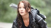 "Jennifer Lawrence as Katniss Everdeen in a scene from ""The Hunger Games"" (Murray Close/AP)"