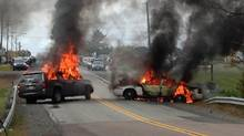 Vehicles burn in eastern New Brunswick on Thursday Oct. 17 after violence erupted near a reserve north of Moncton, N.B. RCMP had earlier moved in on an anti-fracking protest