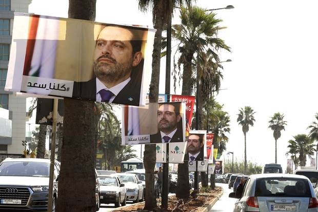 Posters of Lebanese Prime Minister Saad Hariri, who resigned last week in a televised speech airing from the Saudi capital Riyadh, hang on Beirut's seaside corniche on Nov. 10, 2017. The caption in Arabic reads '#weareallsaad.'
