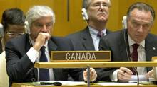 Foreign Affairs Minister Lawrence Cannon and junior minister Peter Kent react after the first round of Security Council voting at UN headquarters in New York on Oct. 12, 2010. (DON EMMERT/AFP/Getty Images)